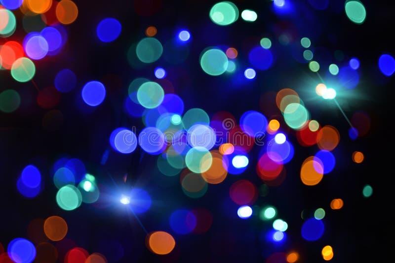 Luzes do feriado na obscuridade fotos de stock