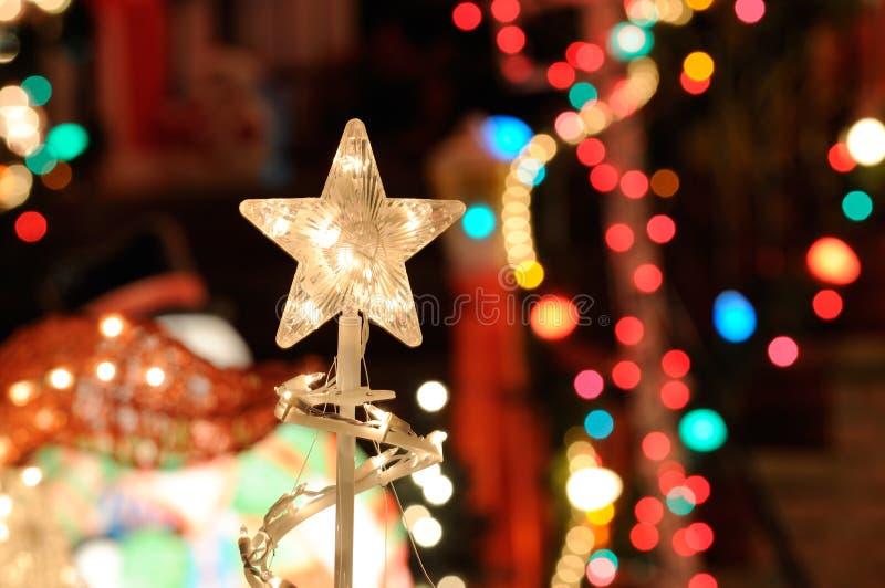 Luzes e estrela de Christmast fotos de stock