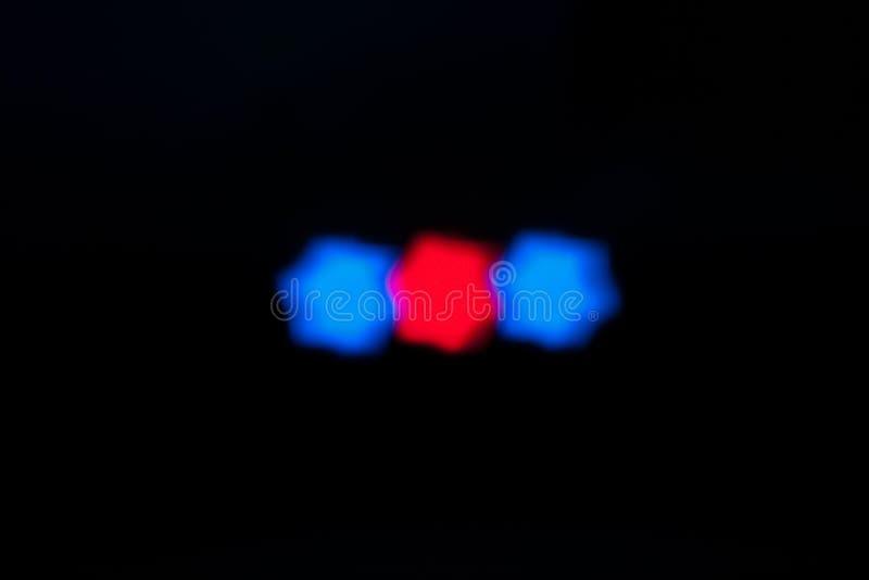 Luzes star-shaped azuis e vermelhas imagens de stock royalty free