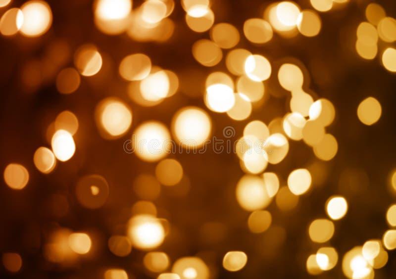 Luzes unfocused amarelas e alaranjadas do feriado fotografia de stock royalty free