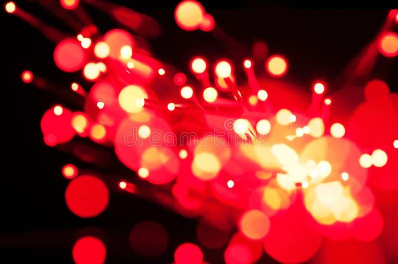 Luzes vermelhas da fibra óptica fotografia de stock royalty free