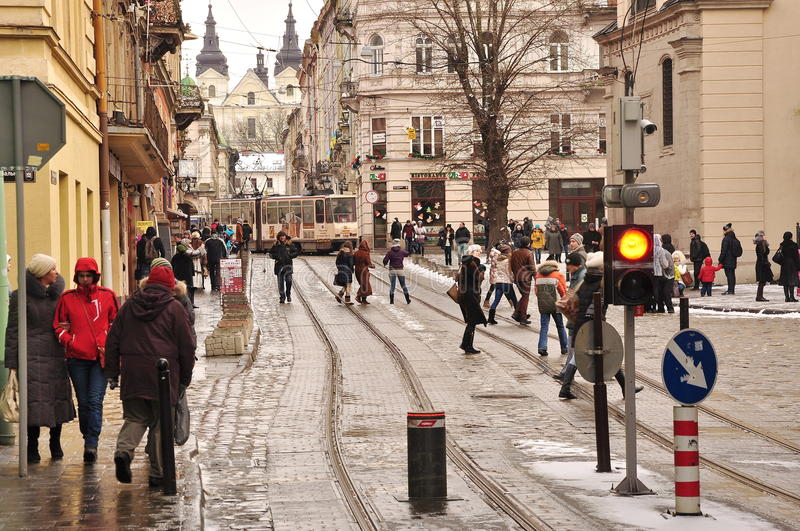 Lviv street. Passersby, tram, medieval architecture royalty free stock photography