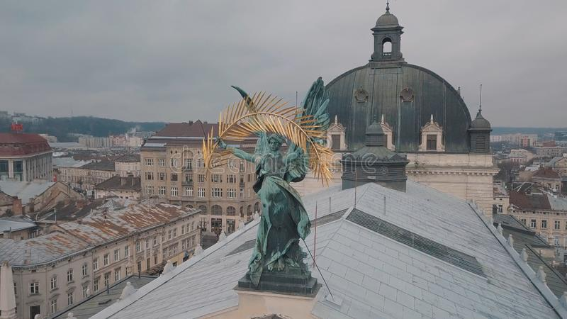 Lviv, Ukraine - 17, December 2019. Aerial City. Popular statue on Lviv Opera royalty free stock photography