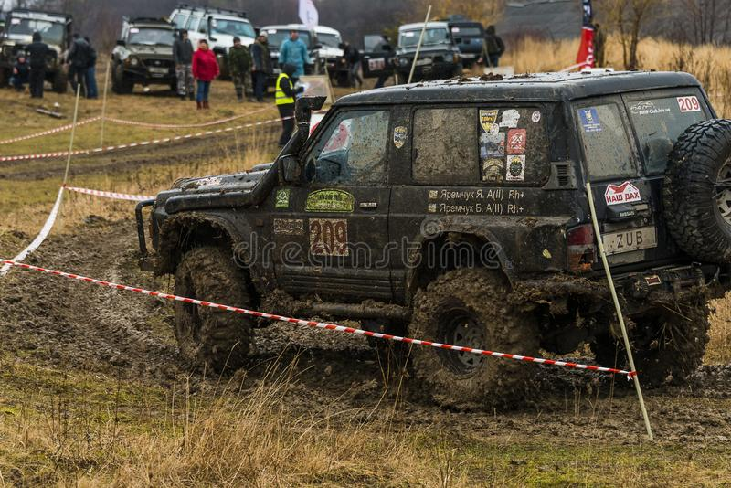Off-road vehicle brand Nissan No. 209 overcomes the track royalty free stock images