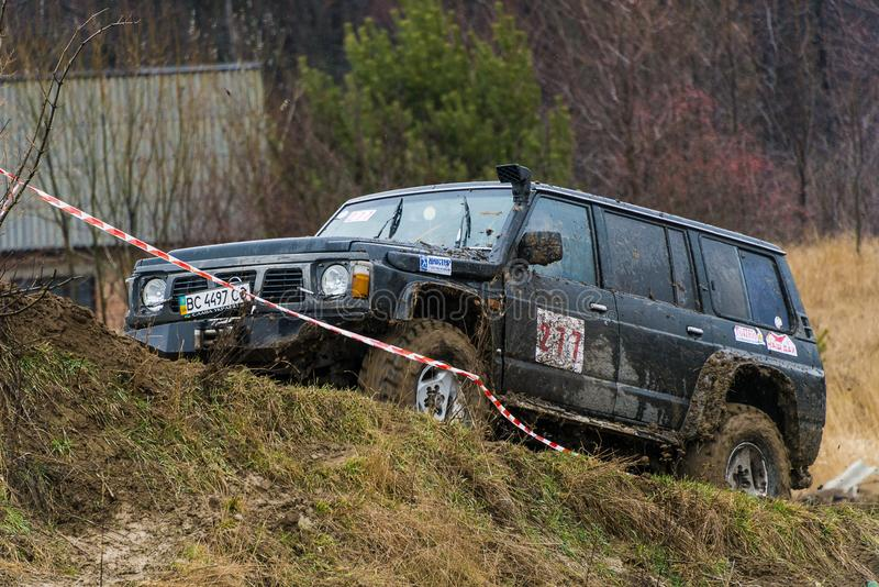 Off-road vehicle brand Nissan No. 277 overcomes the track royalty free stock image