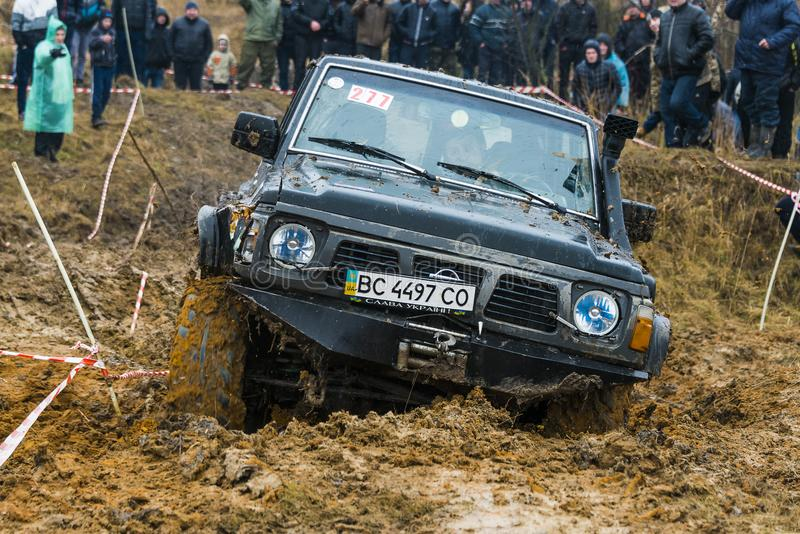 Off-road vehicle brand Nissan No. 277 overcomes the track stock photography