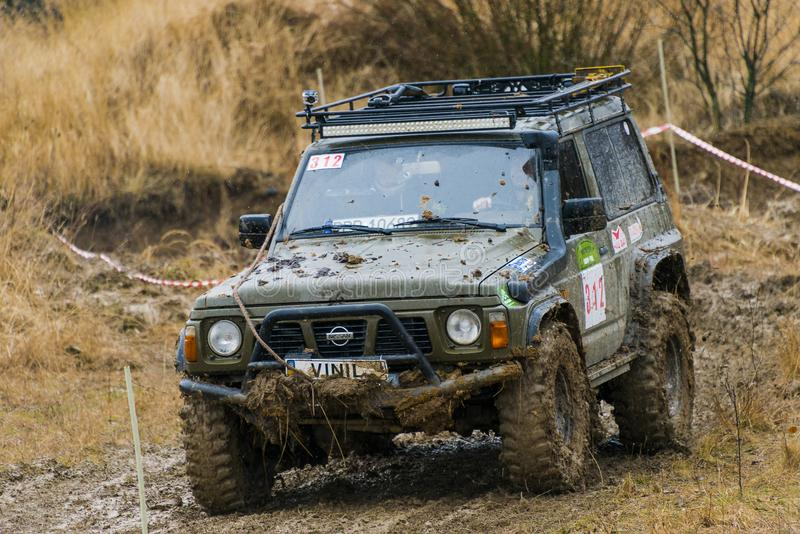 Off-road vehicle brand Nissan No. 312 overcomes the track stock images
