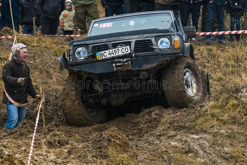 Off-road vehicle brand Nissan No. 277 overcomes the track royalty free stock photos