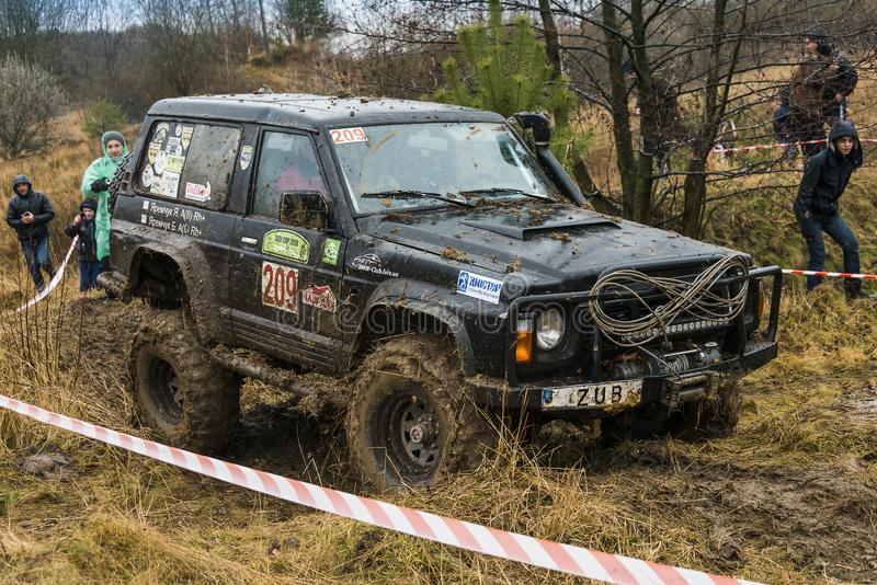 Off-road vehicle brand Nissan No. 209 overcomes the track royalty free stock photography