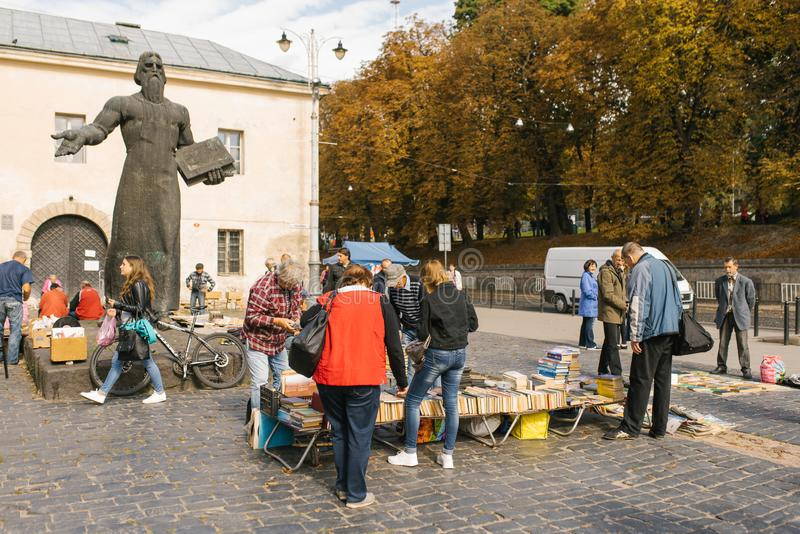 Lviv, Ukraine. Flea book market and a monument to the first printer Fedorov stock images
