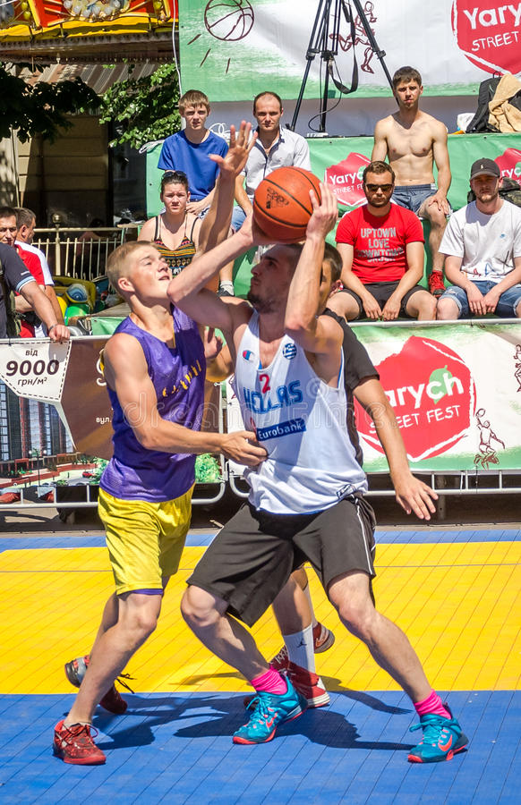 Lviv, Ukraine - July 2015: Yarych street Fest 2015. Street basketball competition at the festival near Lviv Opera House. Players stock images