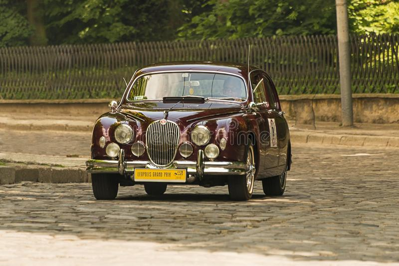 Old retro car Jaguar MK 3 taking participation in race royalty free stock photos