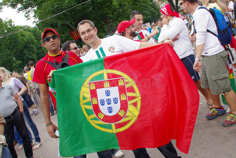 LVIV, UKRAINE - JUNE 9, 2012: Portugal emotional football fans Euro-2012. LVIV, UKRAINE - JUNE 9, 2012: Portugal emotional football fans in the center of the stock image