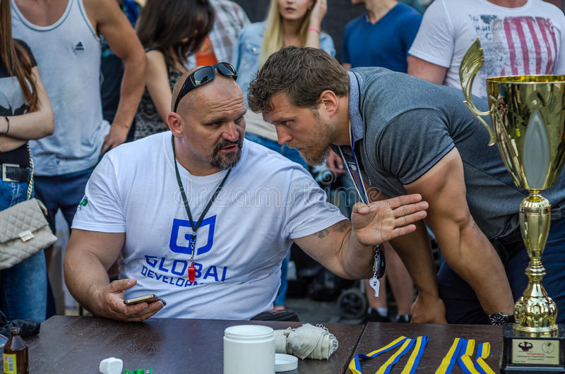 LVIV, UKRAINE - JUNE 2016: The strongest man in the world - strongman Vasyl Virastjuk confers with President of the Association st. The strongest man in the royalty free stock photography