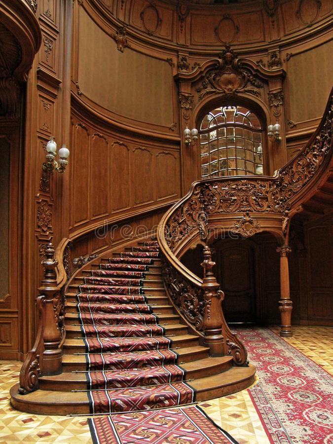 LVIV, UKRAINE - MAY 1: A carved wooden staircase in ancient casino on May 1, 2010 in Lviv, Ukraine stock photography