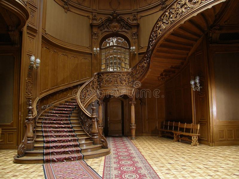 LVIV, UKRAINE - MAY 1: A carved wooden staircase in ancient casino on May 1, 2010 in Lviv, Ukraine royalty free stock image