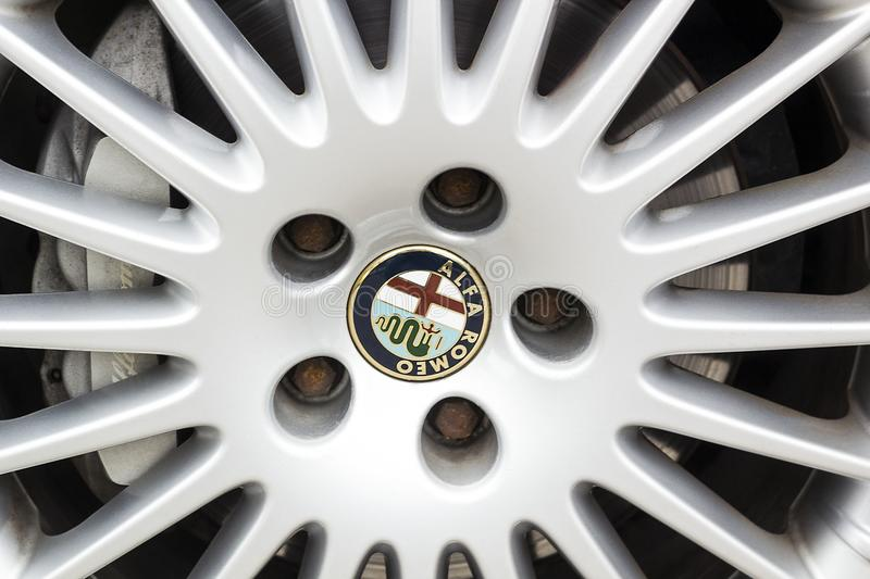 Close-up view of logo on alloy wheel car Alfa Romeo royalty free stock image
