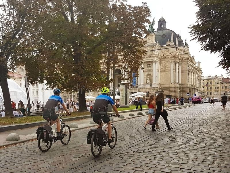 Lviv, Ukraine - sept 16 2018: New urainskaya police on bicycles patrols the center of the old town on Liberty Avenue near the Oper stock image