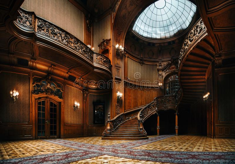 House of Scientists. Mansion with curved wooden staircase, Lviv, Ukraine. Lviv, Ukraine - 23 September, 2016: House of Scientists. Interior of the magnificent royalty free stock image