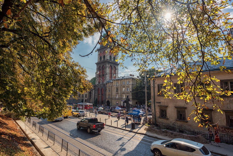 LVIV, UKRAINE - SEPTEMBER 09, 2016: Lviv Citycape and People. Lviv Old Town. Public Transport. Dormition Church, Korniakt Tower. Lviv Citycape and People. Lviv stock photo