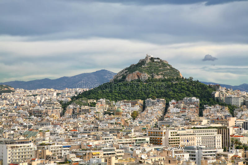 Lycabettus Hill, Athens. View of Lycabettus Hill and the city of lAthens from the Acropolis, Greece royalty free stock photography