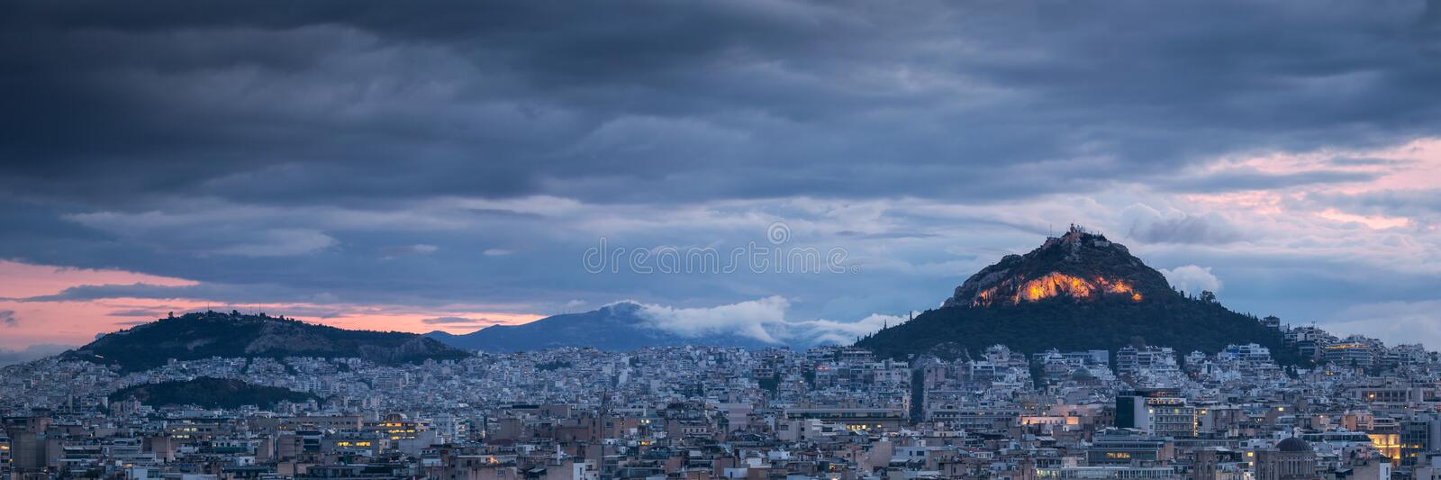 Lycabettus hill in Athens. View of Lycabettus hill from Areopagus hill in central Athens, Greece stock images