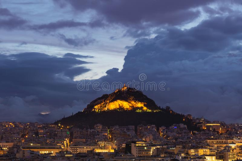Lycabettus hill in Athens. View of Lycabettus hill from Areopagus hill in central Athens, Greece stock photo