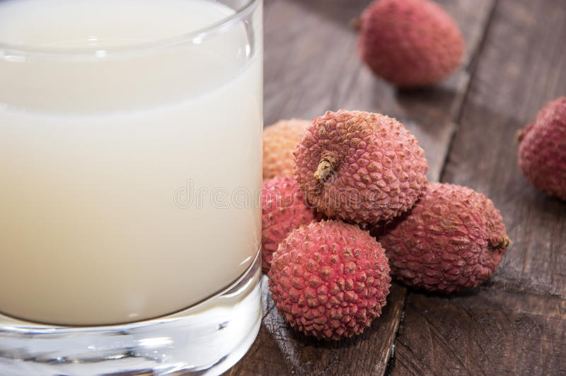 Lychee Juice with fresh fruits royalty free stock photography