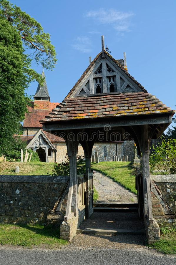 Lychgate. The Church of The Holy Cross, Bignor, Sussex, UK. Bignor is a village and civil parish in the Chichester district of the English county of West Sussex royalty free stock images
