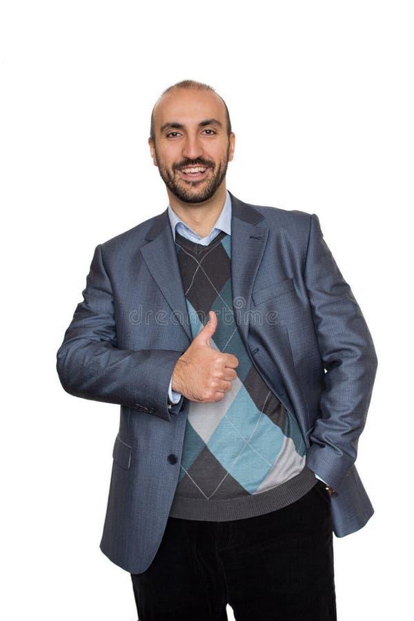 Lyckad affärsman med en handtumme upp arkivfoton