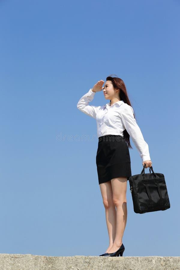 Lyckad blick för affärskvinna arkivfoto
