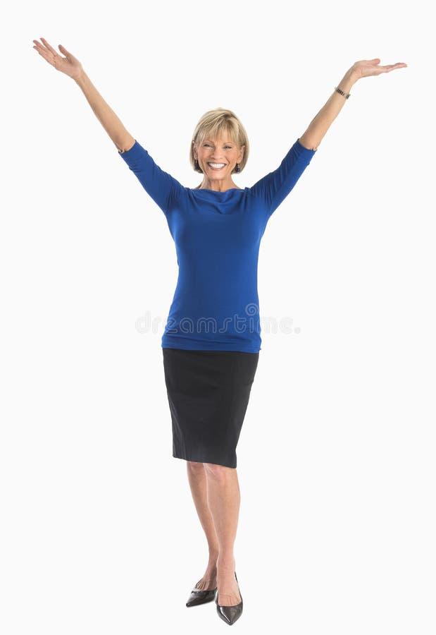 Lycklig affärskvinna With Arms Raised över vit bakgrund fotografering för bildbyråer