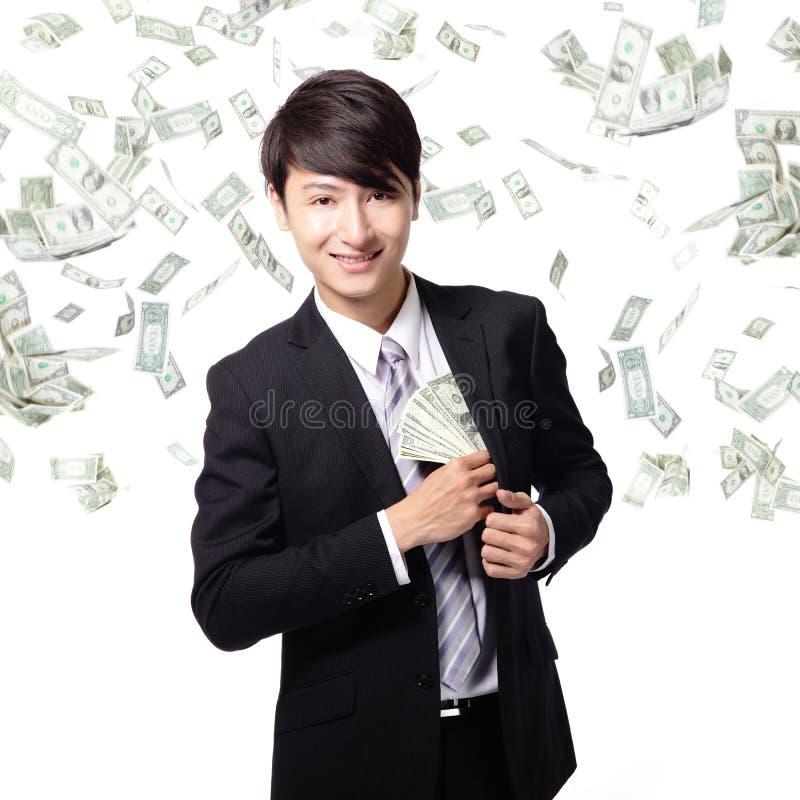 Lycklig affärsman med oss pengar arkivfoton