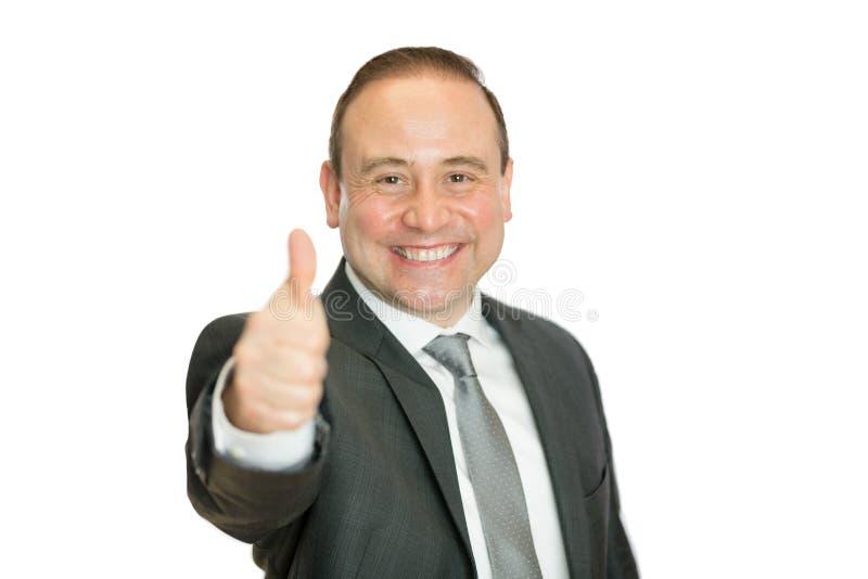 Lycklig affärsman som ger upp tummar med kopieringsutrymme royaltyfri fotografi