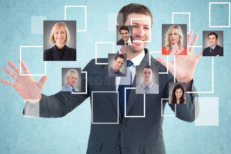 Lycklig affärsman som väljer kandidater royaltyfria bilder