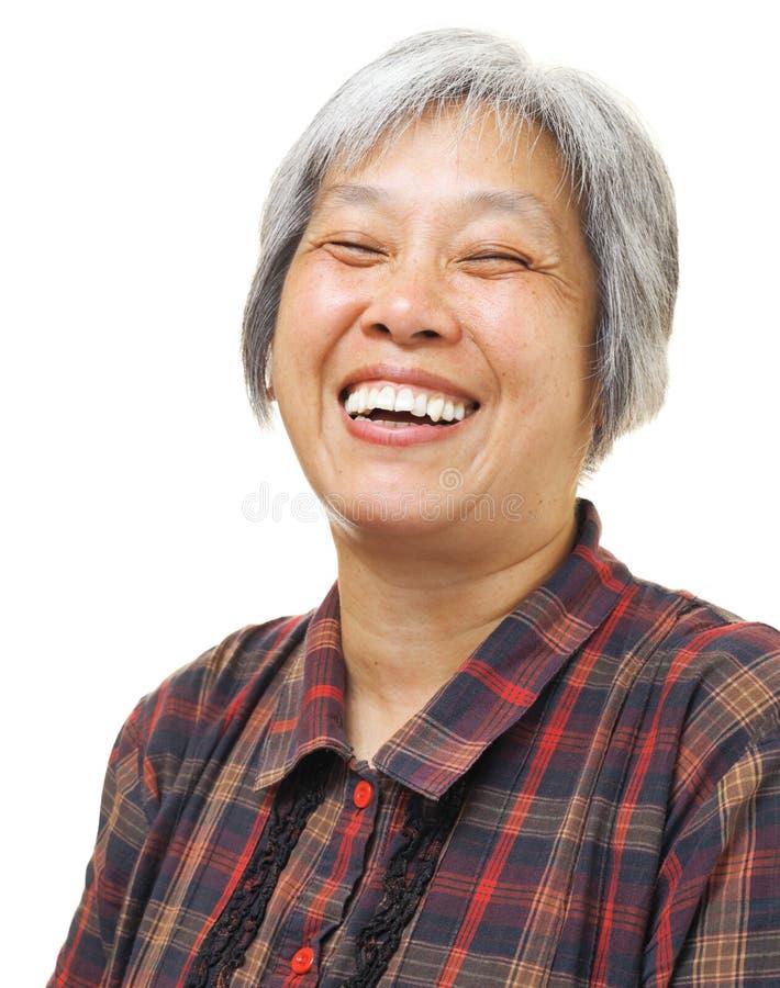 Lycklig asiatisk känsel för gammal kvinna royaltyfri fotografi