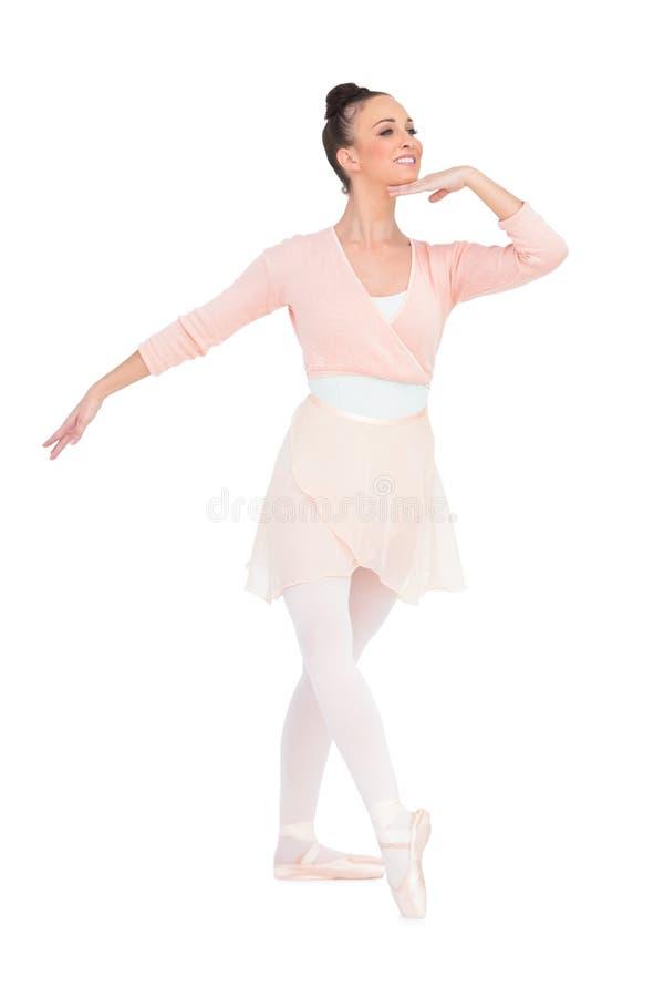 Lycklig attraktiv ballerina som poserar att se bort fotografering för bildbyråer