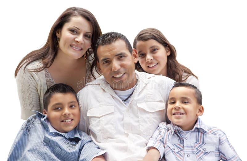 Lycklig attraktiv latinamerikansk familjstående på vit royaltyfri fotografi