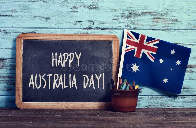 Lycklig Australien för text dag i en svart tavla arkivfoto