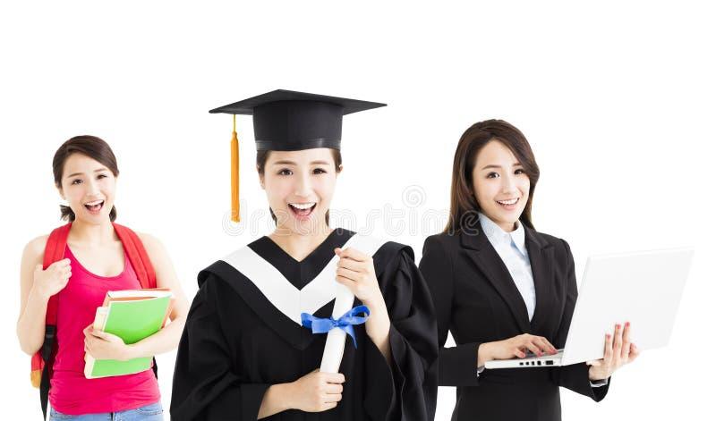 Lycklig avläggande av examen mellan studenten och affärskvinnan fotografering för bildbyråer