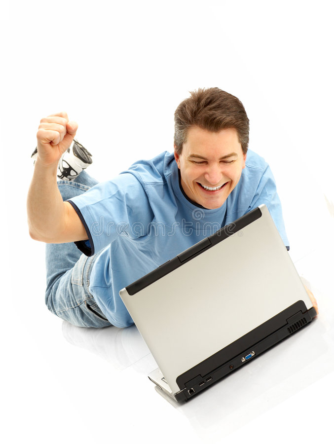 lycklig bärbar datorman arkivbild