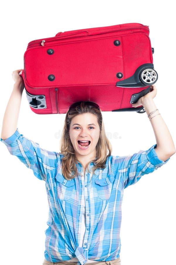 lycklig bagagehandelsresandekvinna royaltyfri bild