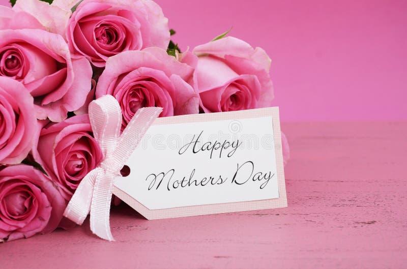 Lycklig bakgrund för rosor för moderdag rosa arkivbild