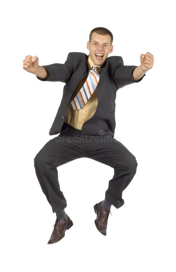lycklig banhoppning för affärsman arkivfoto