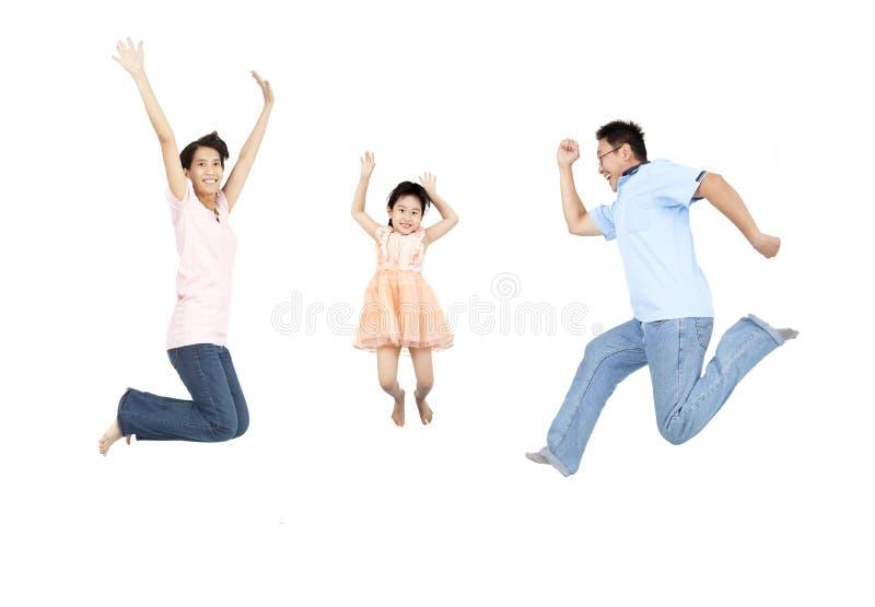 lycklig banhoppning för familj arkivfoton