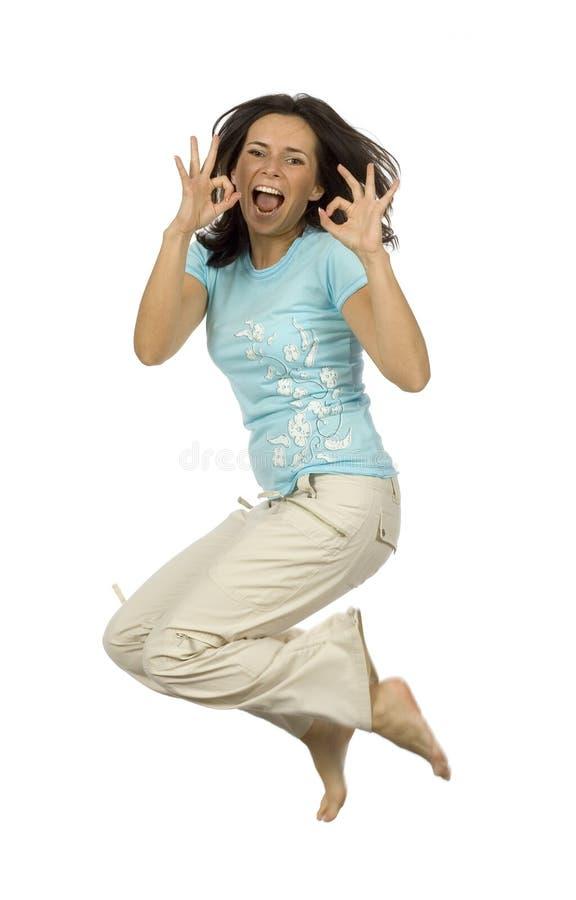lycklig banhoppningkvinna royaltyfria foton