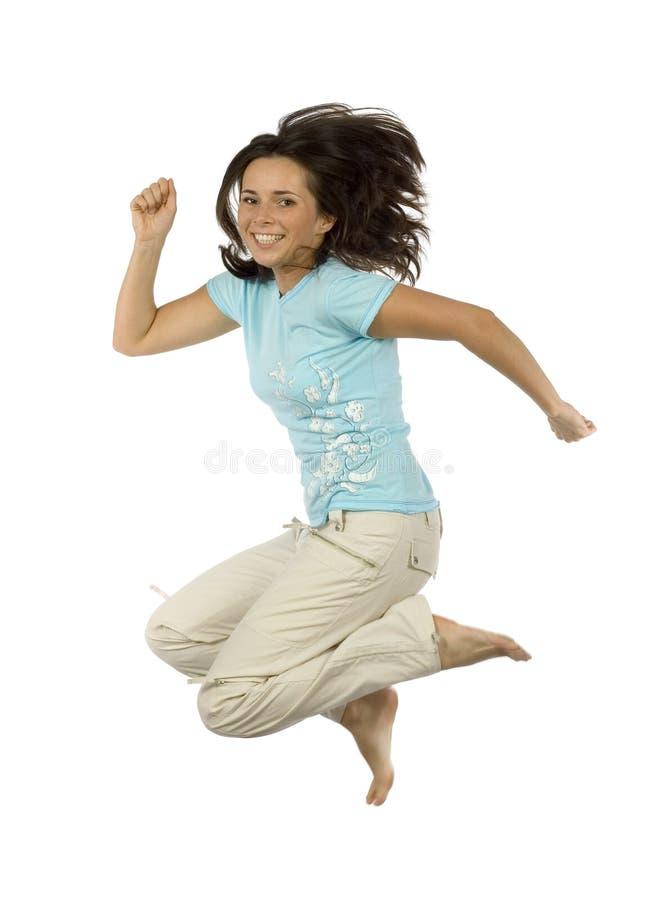 lycklig banhoppningkvinna arkivfoton