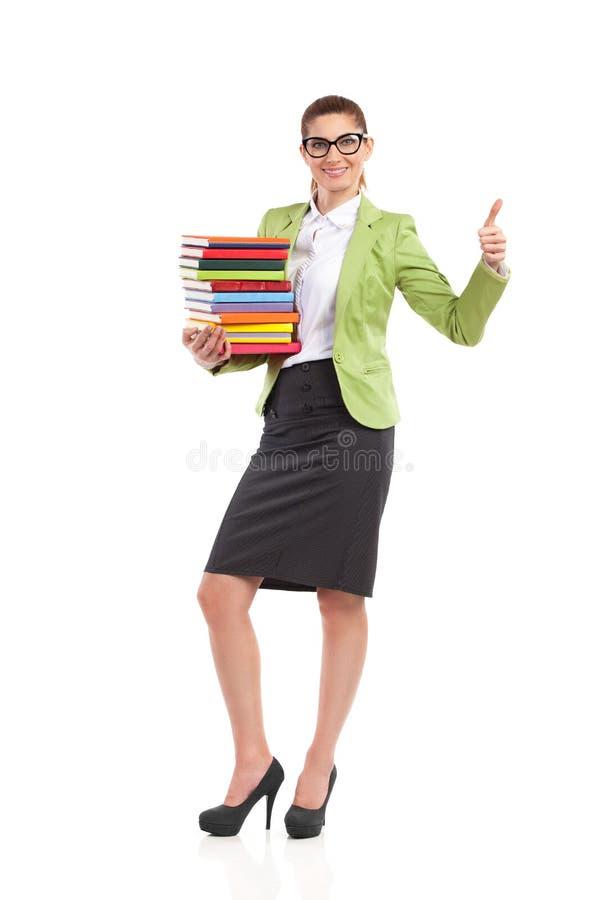 Lycklig bibliotekarievisningtumme upp. arkivbilder