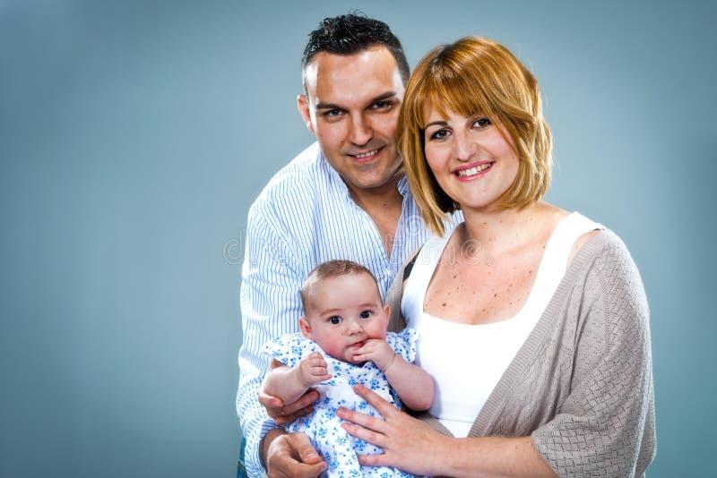 Lycklig Caucasian familj fotografering för bildbyråer