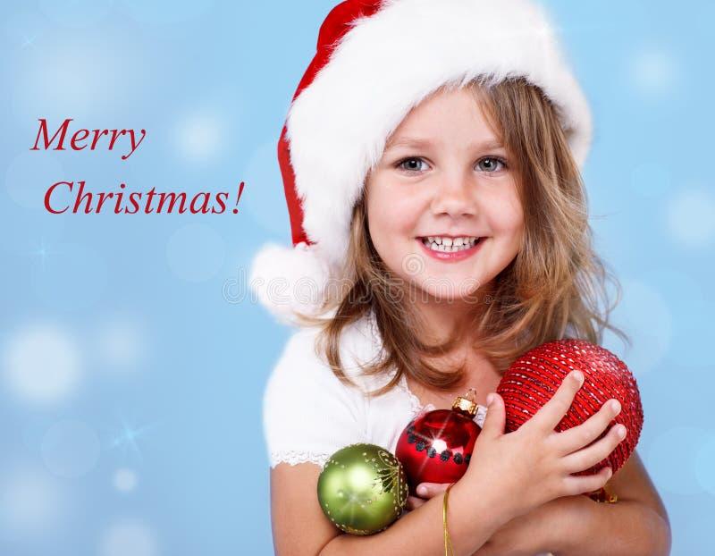 Lycklig förträningsflicka i den Santa hatten arkivbilder